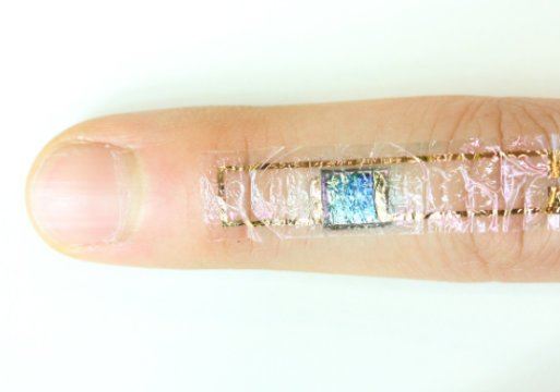 A self powered heart monitor taped to the skin