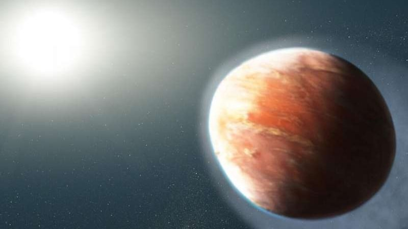 cropped Distant heavy metal gas planet is shaped like a football