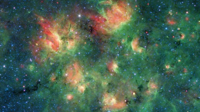 cropped Spitzer spots a starry region bursting with bubbles