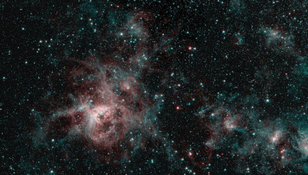 Tarantula Nebula spins web of mystery in Spitzer image scaled