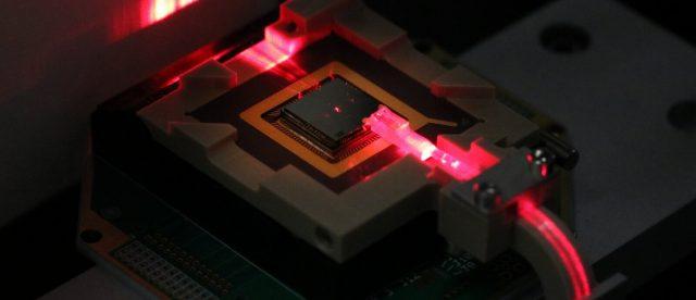 Control ions for quantum computing and sensing via on chip fiber optics