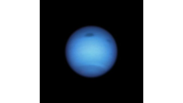 Dark storm on neptune reverses direction possibly shedding a fragment