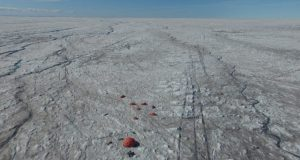 Microbes fuelled by wind blown mineral dust melt the Greenland ice sheet