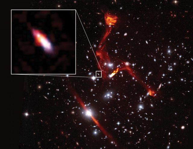 Cosmic lens reveals faint radio galaxy